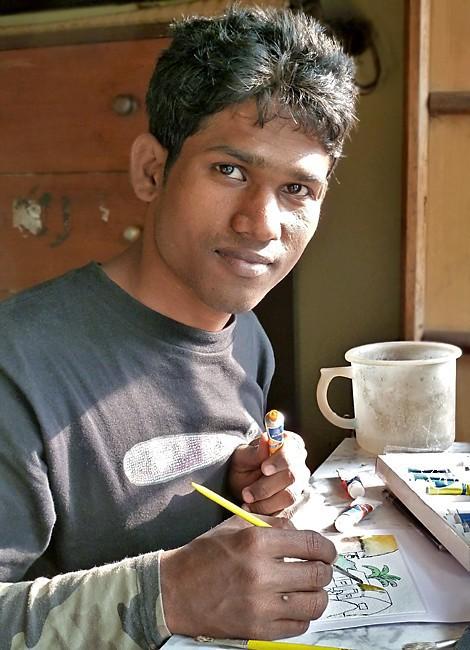 Prakash peint une aquarelle